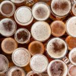 glasses full of frothy beer